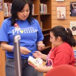 Librarian Blanca Patlan engages with a student about a book.