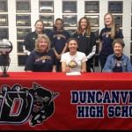 Kirby Anderson signs her letter of intent to play college volleyball with her family and coaches by her side.