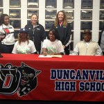 Victoria Hicks signs her letter of intent to play college volleyball with her family and coaches by her side.
