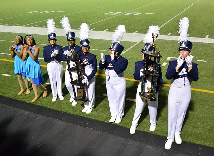 Drum+Majors+and+high+hat+captains+proudly+accept+their+tropes+at+the+close+of+the+Plano+Marching+contest.+%28Karla+Estrada+Photo%29