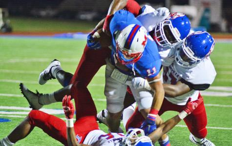 A host of Duncanville defenders wrapup Waco Midway's top running back in a close 42-36 game. (Karla Estrada photo)