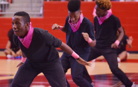 The step team opens up for  the Cedar Hill pep rally. The team started up this year and has become a regular performance group at school events. (Karla Estrada photo)