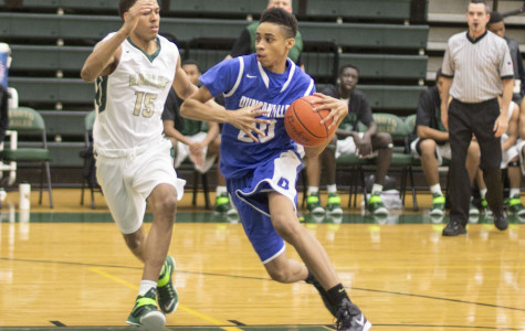 Senior Cameron Hunt turns the corner against a DeSoto  defender in a tough fought game Friday night. (John Hunt photo)
