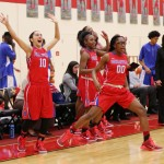 Senior Guard Jazmine Taylor and freshman Zarielle Green celebrate a 57-39 victory over South Grand Prairie in the first round of district play. (Karla Estrada photo)