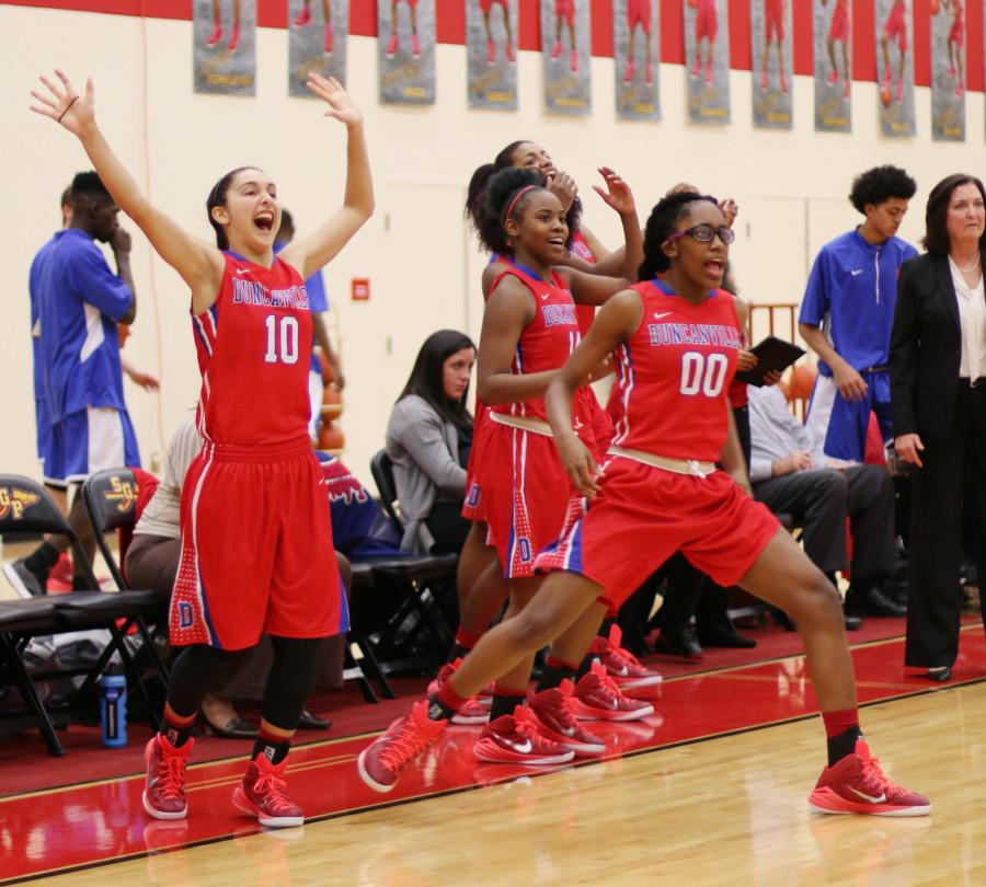 Senior+Guard+Jazmine+Taylor+and+freshman+Zarielle+Green+celebrate+a+57-39+victory+over+South+Grand+Prairie+in+the+first+round+of+district+play.+%28Karla+Estrada+photo%29