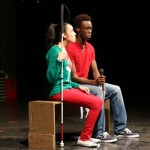Junior Davion Smith sings a special piece in the play with his friend Emily who is blind. (Taryn Marceleno)