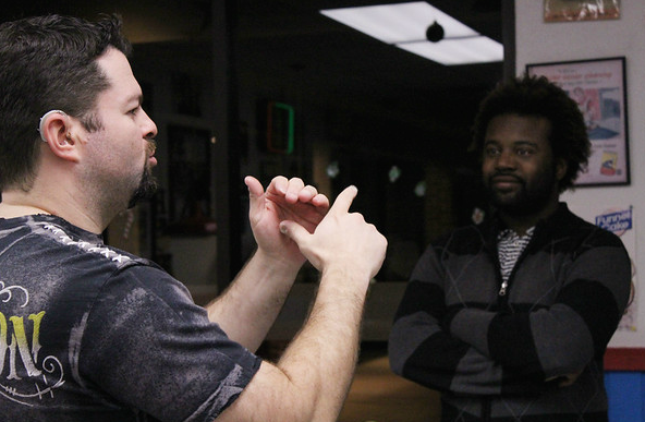 American Sign Language teacher Matthew Snelling speaks to a person in their language during a deaf chat event at Hav-R burgers in town. (Kennedy Stidham photo)