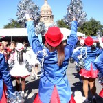 "As the High High Hats make their way down Congress Avenue towards the capital, those in attendance at the Governor's Inaugural parade cheer them on with chants of ""DUNCANVILLE"" (Cynthia Rangel Photo)"