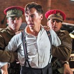 A still from the movie in which Turing, portrayed by Cumberbatch, is restrained by officers. The movie is based in the World War II era.