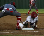 Duncanville player slides onto a base during the game against Cedar Hill. (Photo by Olivia Colchado)