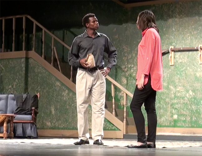 Two+theatre+students+act+out+a+scene+of+the+happy-go-lucky+play.+