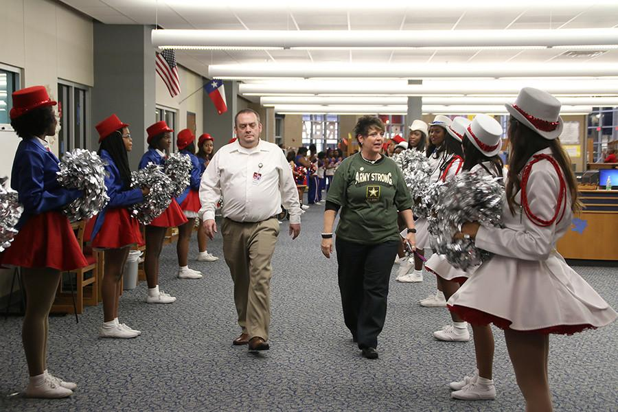 This was the third annual veterans day luncheon. The choir, high hats, sparklers, and cheerleaders were present to show their appreciation. Here, two veterans are welcome with applause. (Photo By: Cynthia Rangel)