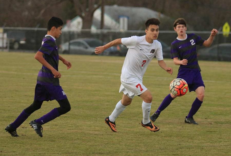 Senior James Labastida moves the ball between two Bonham defenders during the Panthers 5-0 win to open the Duncanville Classic. (Michelle Villegas photo)