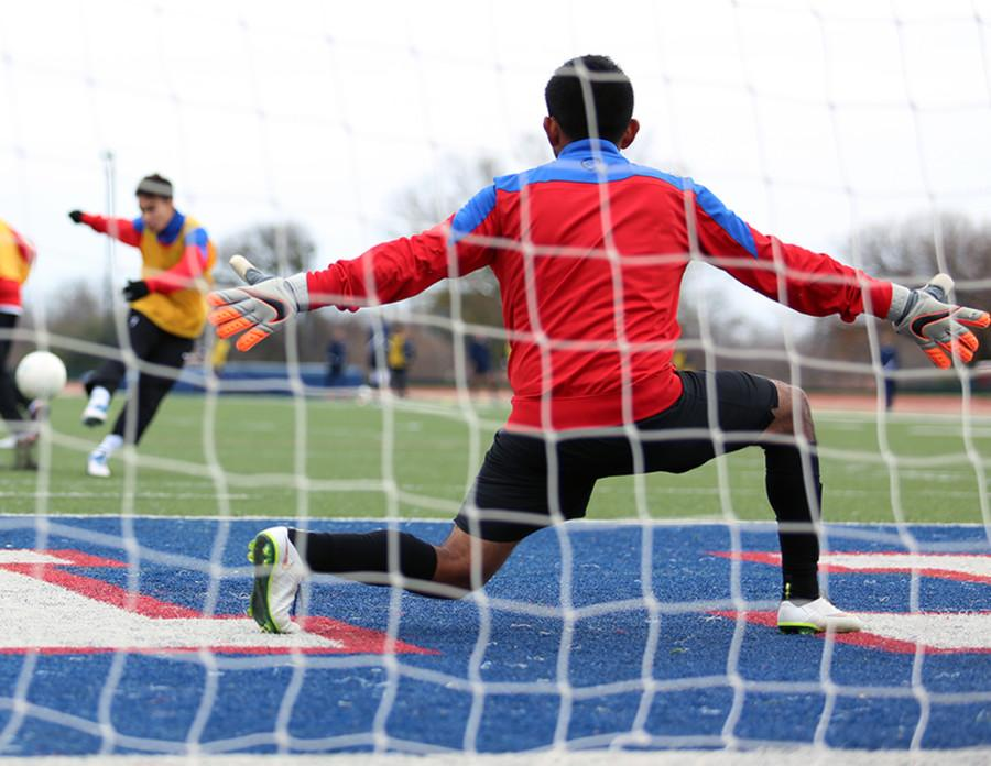 Senior Goalie Alexis Araiza works on his goal tending during warmups prior to the Jesuit matchup.  He allowed no goals during the gam.(Photo by Karla Estrada)