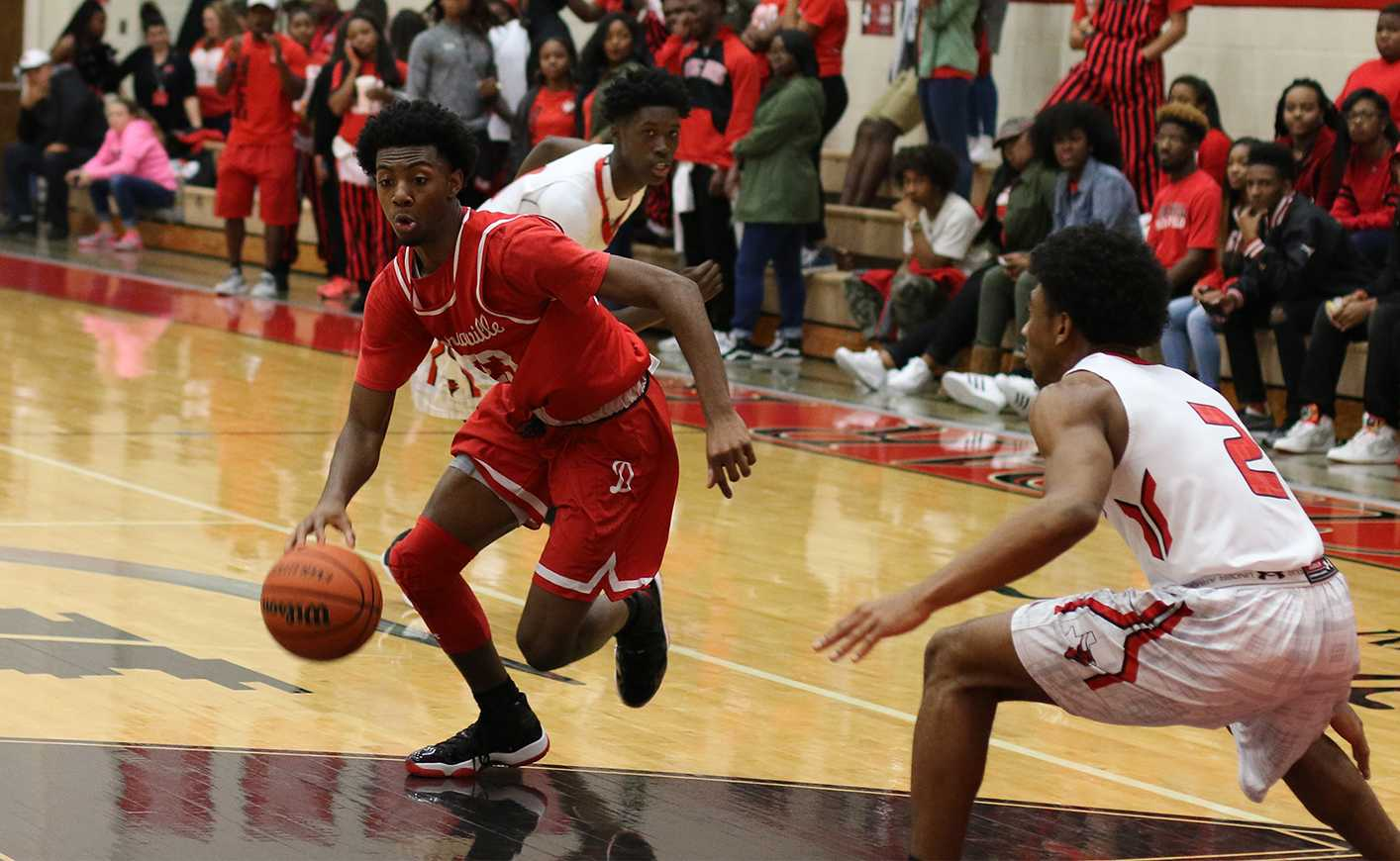 Duncanville player drives in paint as he is loosely guarded by a Cedar Hill player. (photo by: Ricardo Martin)