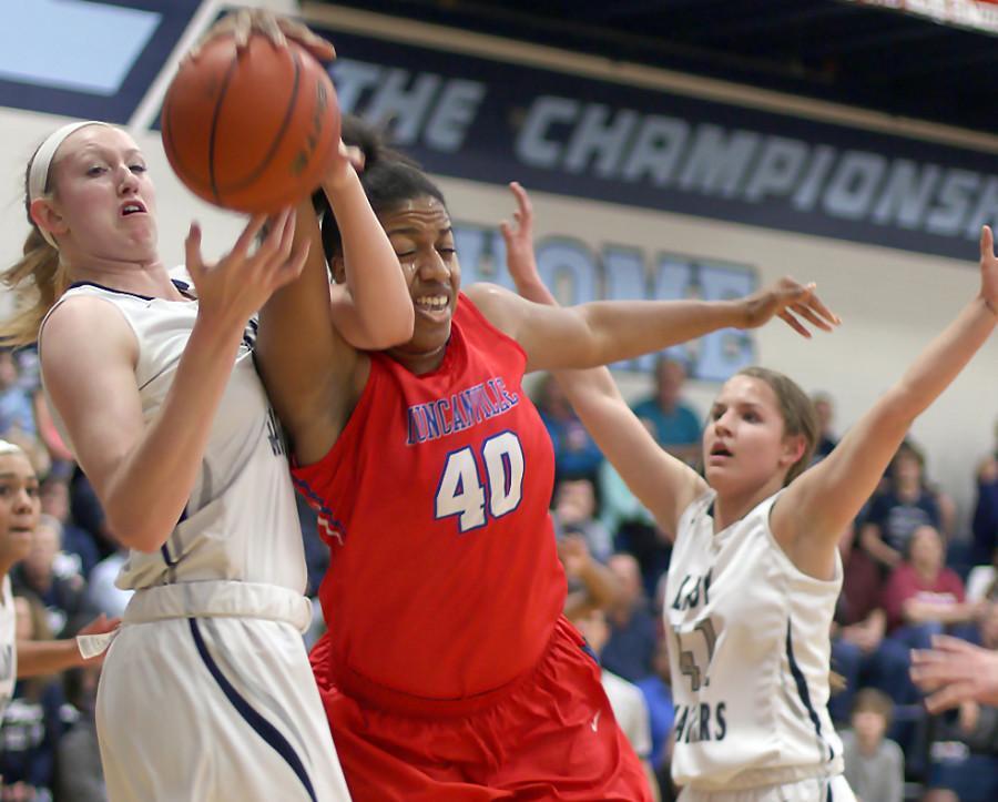 Senior Cierra Johnson fights for the rebound against Flower Mound's Lauren Cox. (Kyhia Jackson photo)