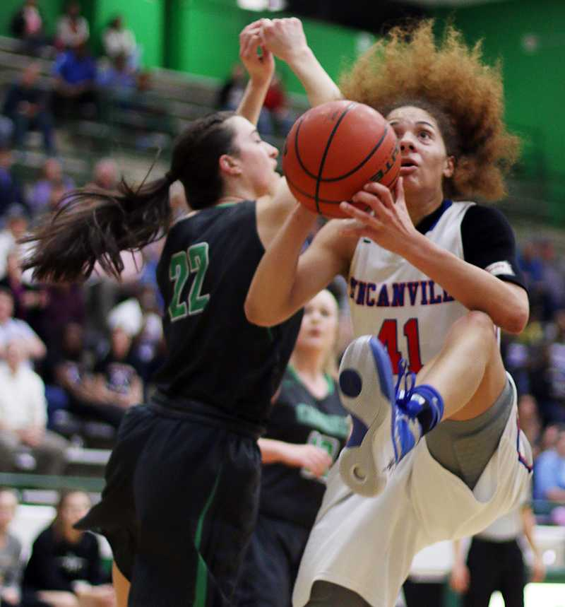 Senior+Madison+Townley+presses+past+a+Southlake+defender+during+their+Bi-District+matchup.+%28Karla+Estrada+Photo%29
