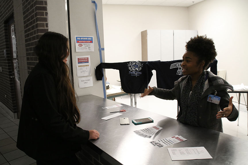 Senior marketing student Joycelyn Stewart interacts with a potential customer. (Photo by: Melissa Retina)