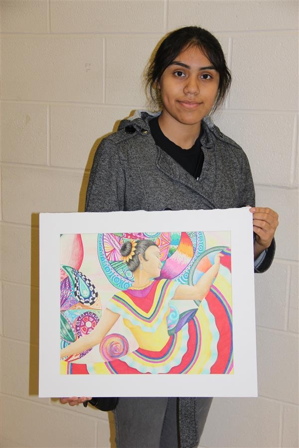 A+student+poses+with+her+artwork.+This+is+one+of+30+pieces+that+received+distinction+at+the+recent+VASE+competition.+%28Submitted+photo%29