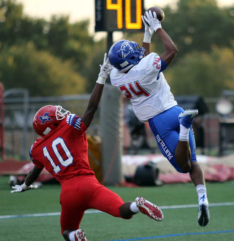 Sophomore cornerback Jalen Byrd goes up high looking for the interception in  a matchup with Arlington Sam Houston. (Photo by Emlyn Almanza)