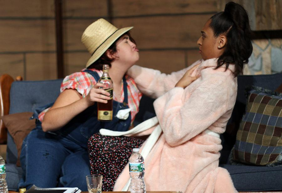 Natalie Cossio(Cora Gump) and Ayana Reed(Myra Marlow) have a discussion while Cossio is drinking. (Dillon Clarke photo)