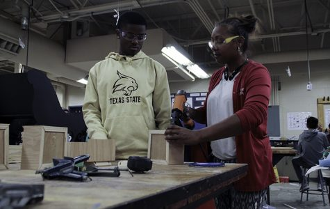 Duncanville Students build floats for the Christmas parade
