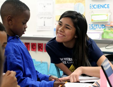 Students become teachers for youngsters during visits to elementary schools. (Joel Lopez photo)
