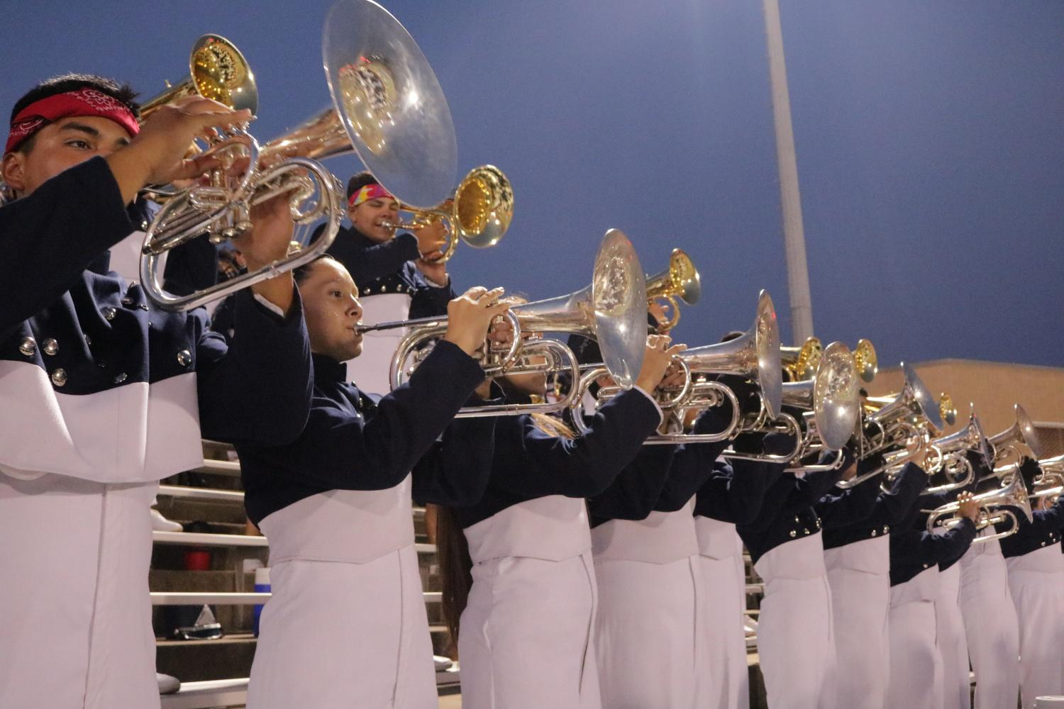 The band plays in the stands at a football game prior to their halftime show. (Gloria Ogunlade photo)