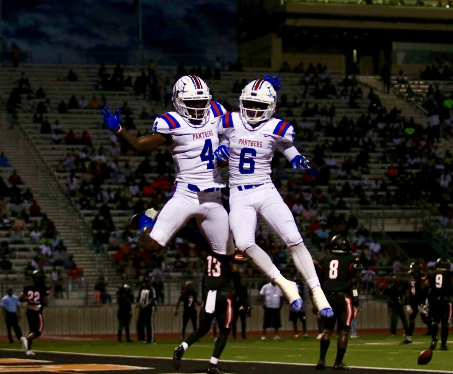 Zeriah Beason (4) celebrates with Marquelan Crowell (6) after a touchdown by Beason against the Lancaster Tigers.