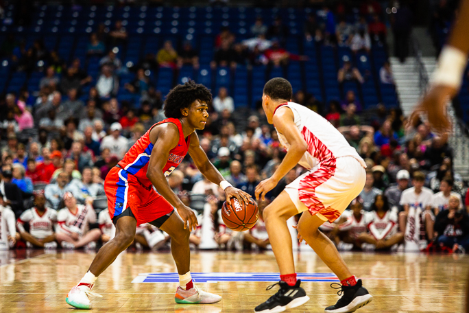 Junior Jabryant Hill (2) drives against the defense in the state semi final basketball game.