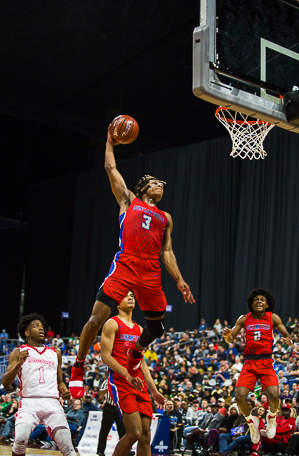 Jahmius Ramsey (3) goes up for the slam vs North Shore in the UIL state semi final.