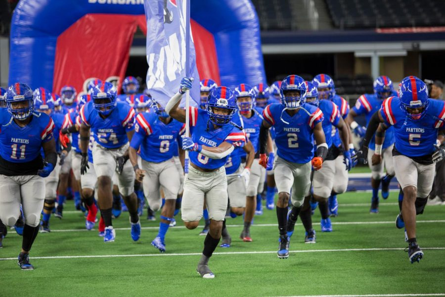 Duncanville Football team Running out for game against Flower Mound
