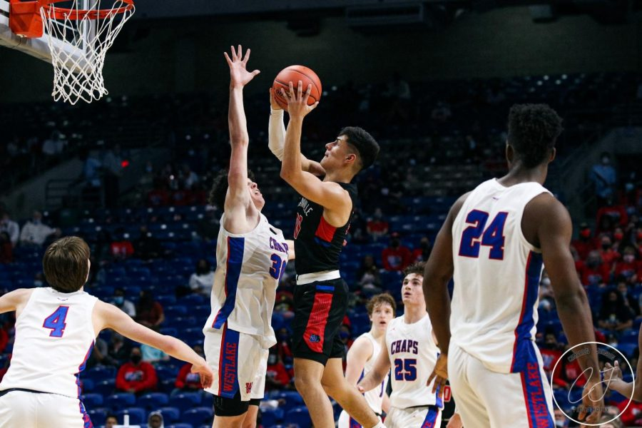 Juan Reyna goes up for the basket during the UIL state championship game.